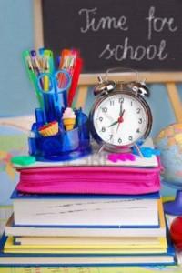 school equipment and retro alarm clock